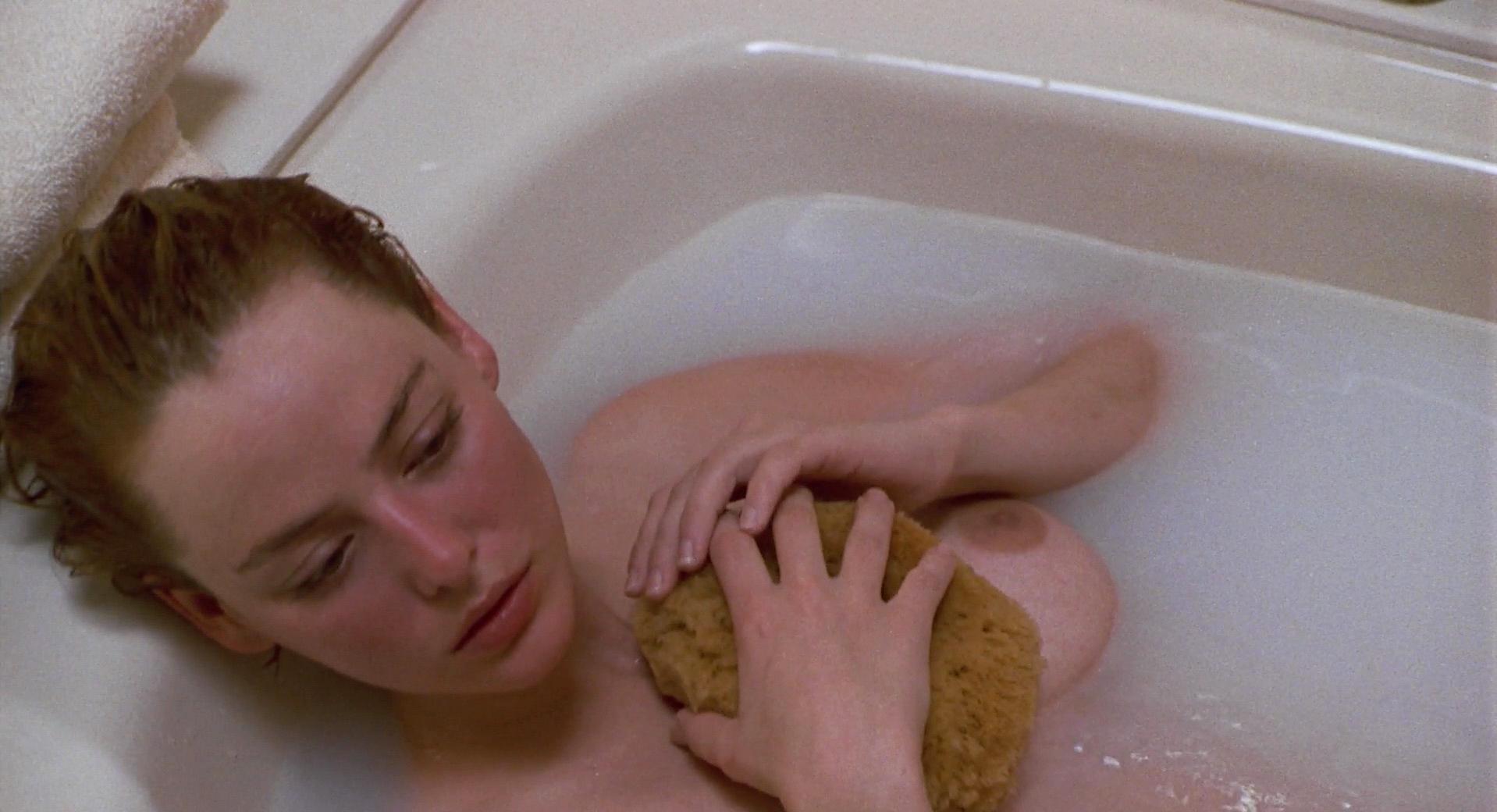 Virginia Madsen nude - Candyman (1992)