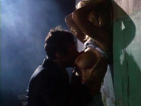Pamela Anderson nude, April Bogenschutz nude - Raw Justice (1994)