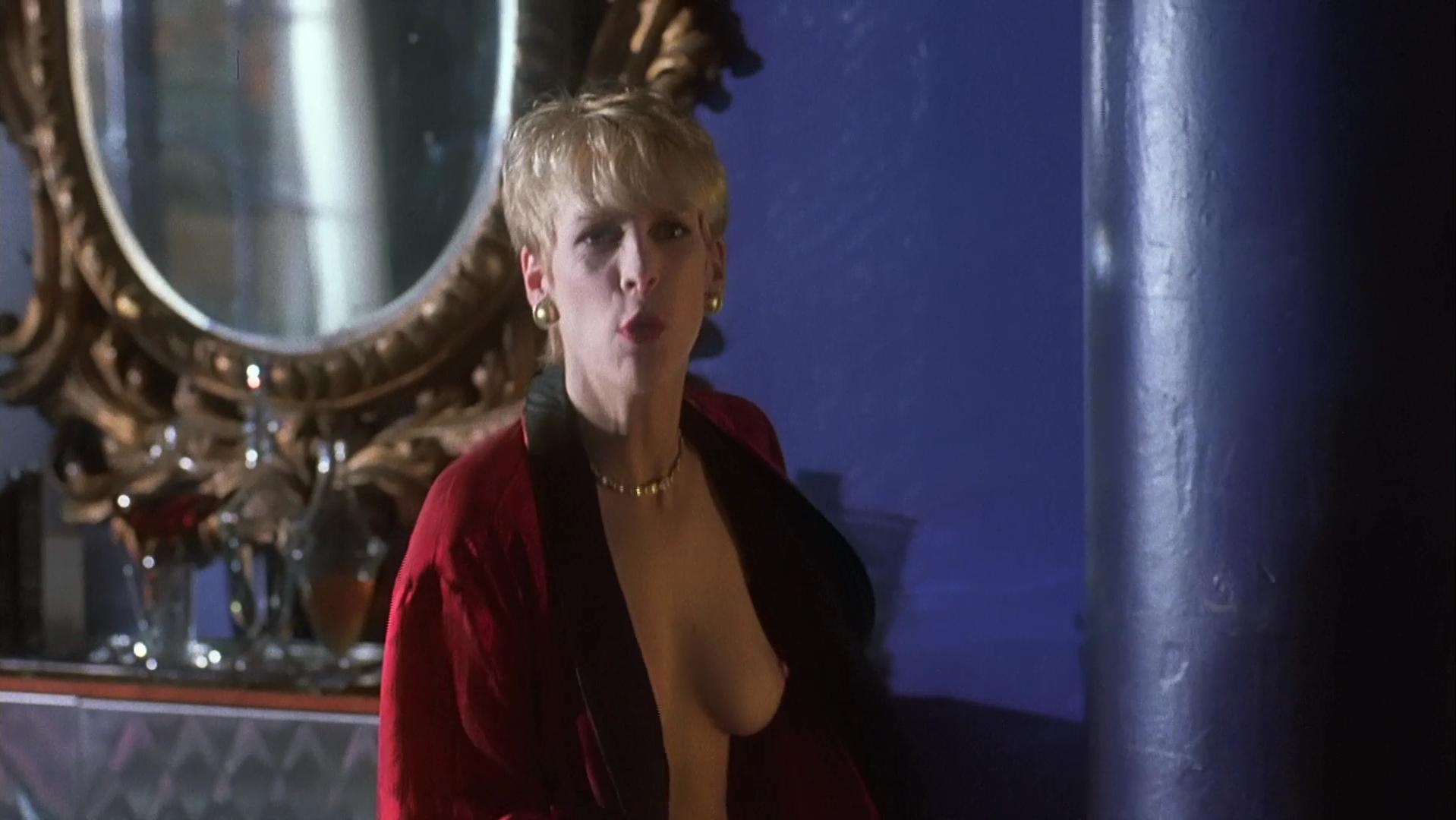 Jamie Lee Curtis nude - Mother's Boys (1994)