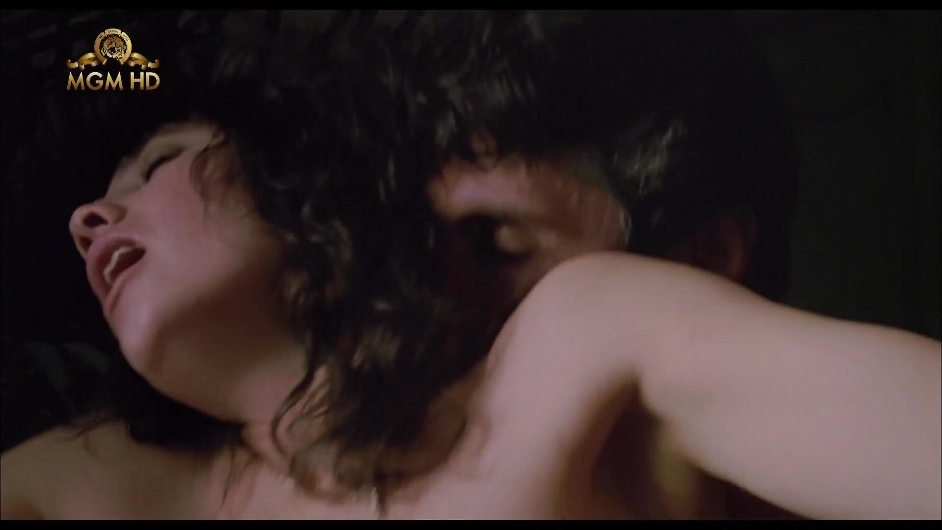 Daphne Zuniga nude - Last Rites (1988)